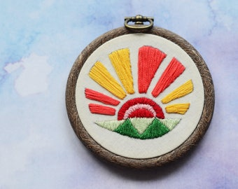 "Sunrise embroidery hoop art in 3"" hoop. Home decor; embroidered art; bold sun rays and fields design"