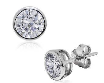 Striking CZ Diamond Stud Earrings, Rub-Over Setting in 925 Silver. Round, Measuring 8.5mm.