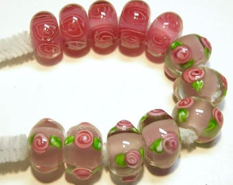 DESTASH -- 12 Lampwork Boro Rondelle Beads: Pinks and Green Flowers and Spital Designs -- Lot 3P