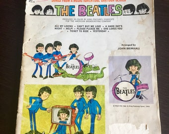 Vintage Beatles cartoon series song book by Hansen