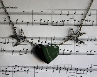 Petit British racing green colour label record necklace with bronze swallowtails. Cut from a pre-loved record