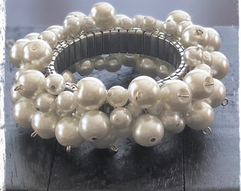 Pearl Jam - cha cha style stretch bracelet with white faux pearls on a silver plated stainless steel base