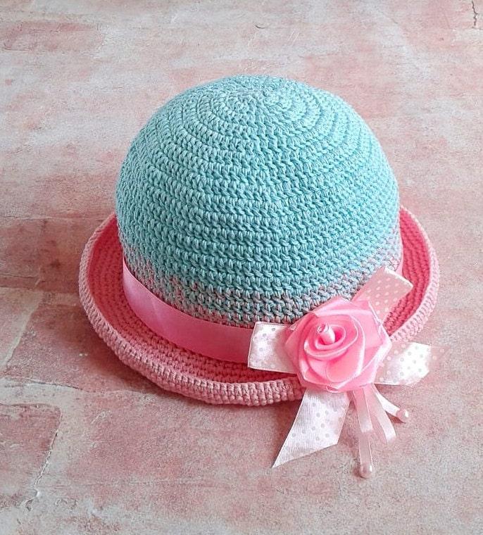 Häkeln Sie Babymädchen Sonnenhut Baumwolle. Rosen-Blumen-Hut.
