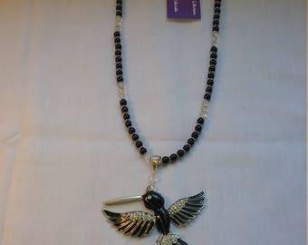 Black bird necklace.