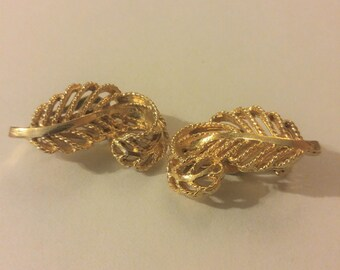 Lisner leaf or feather design clip-on earrings  Open work left-right pair