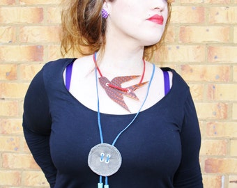 Handmade LEATHER fringed/ tassel button design NECKLACE.  Cute, 50s style button design, blue/silver