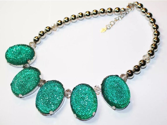 Glitzy sea blue green sparkly ovals along with crystals & silver tone beads This statement necklace is holiday disco party ready. Signed
