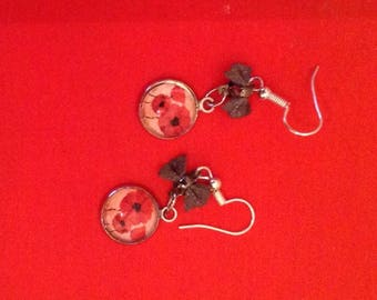 Dangling bow and cabochon earrings