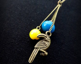 Brass bead and button boots colored toucan necklace