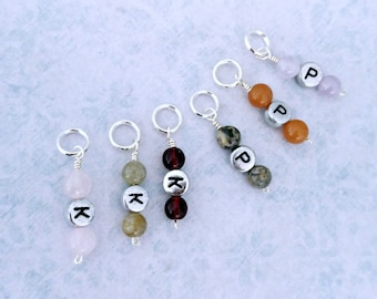 P (purl) and K (knit) stitch markers to mark your row. Silver plated with soldered ring. Made by Kathryn of Crafternoon Treats