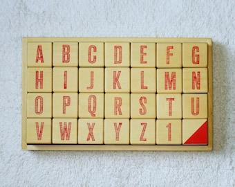a b c d alphabet set in orange triangle