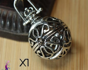 A 41mm cage pendant charms silver metal ball