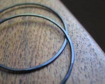 black earrings. black hoops in niobium wire. Made in Canada.