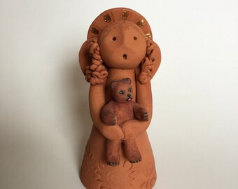 Rustic Angel holding a little Bearcup