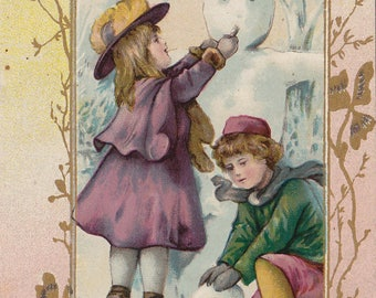 Antique Victorian late 1800s card Boy and Girl building SNOWMAN Chromolithograph