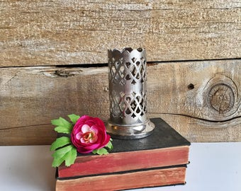 Silver punched sides holder. Silver pencil holder. Silver votive candle holder. Made in England.