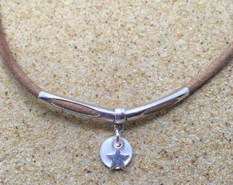 Little Star - mother of pearl necklace on thick brown leather thong.