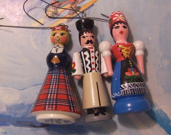 three adorable european ornaments