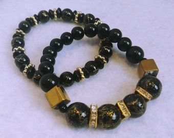 Black glass beaded bracelets accented with gold rondelles (set of 2)