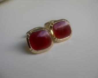 old, orange-red glass cufflinks