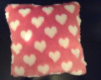 Furry pink hearts cushion