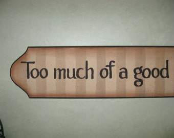 "Wooden plaque...""Too much of a good thing is wonderful""....oversized 4 ft x 8 in rich browns & tans"