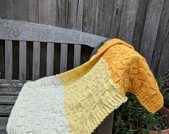 Colourblocked 100% wool blanket in yellow and cream