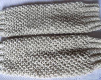 Pair of leg warmers gaiters in knit stitch, beige.