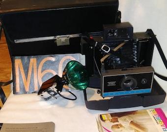vintage Polaroid camera M60