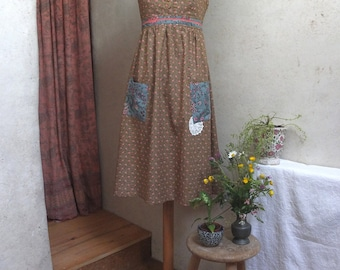 Sundress with straps, pockets and waistband, size 38