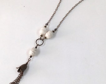 Long layering necklace with white beads