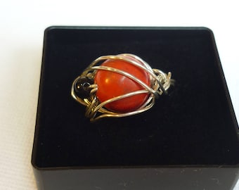 Red and black handcrafted silver ring