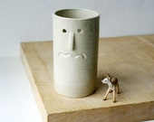 One ceramic vase with face design - glazed in simply clay