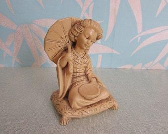 Vintage ivory resin sitting Geisha girl figurine