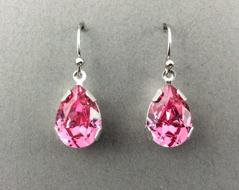 Crystal Earrings With Pearl Shaped Fuchsia Crystal In Silver