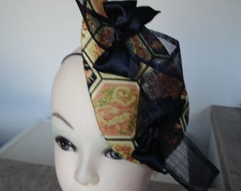 Black and gold fascinator in a oriental style