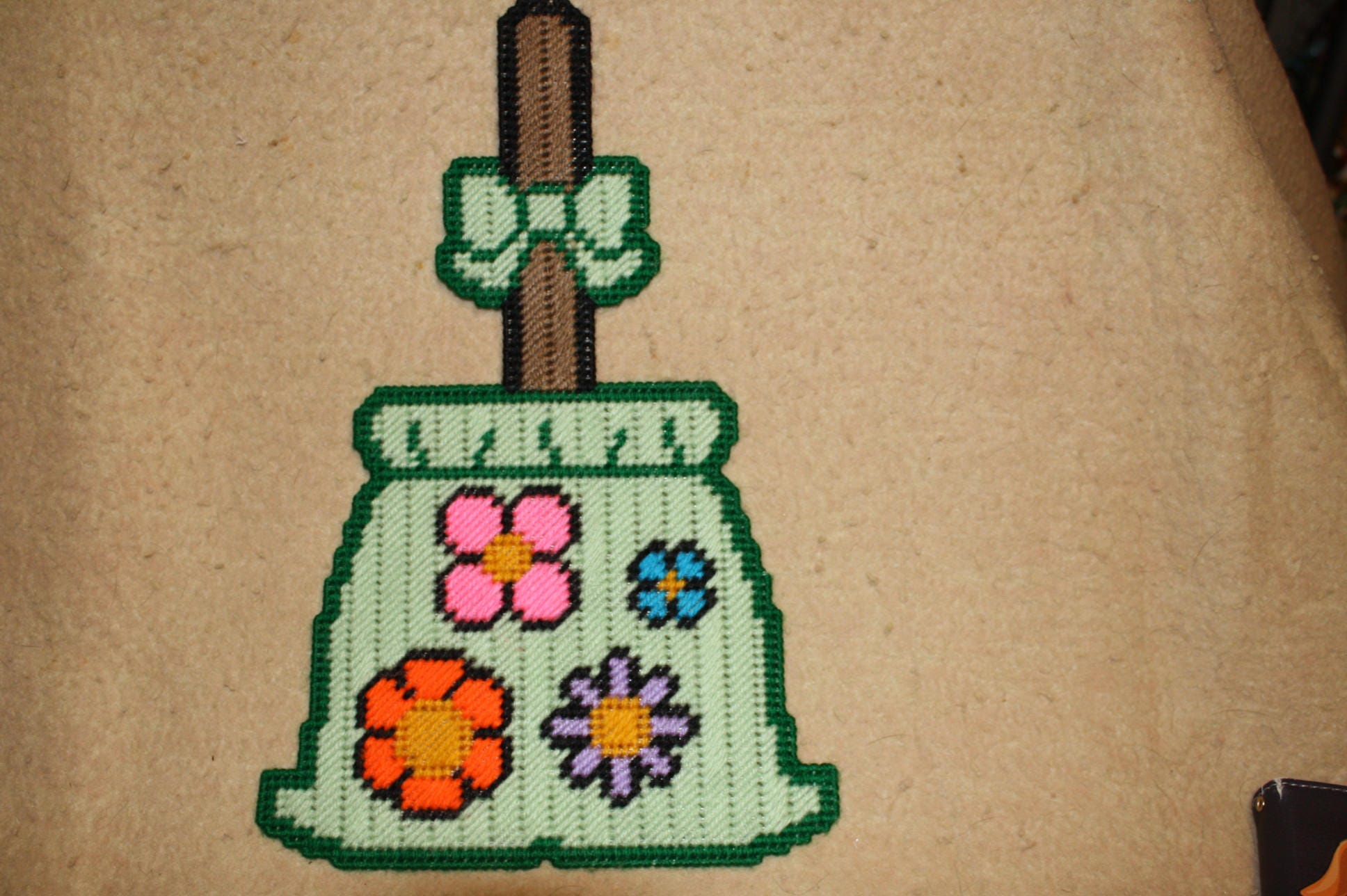 Flower broom wall hanging