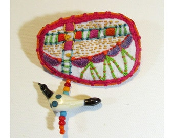 Hand Embroidered Colorful Pin with Hand Blown Glass Spotted Bird