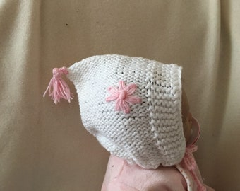 White knitted hat for babies