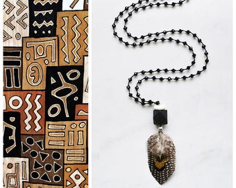 CBN005 - Long boho beaded necklace with brown-gray-beige feathers, black wood, white coral and black crystals.