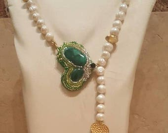 Sets in pearls of river, malachite stone and crystals.