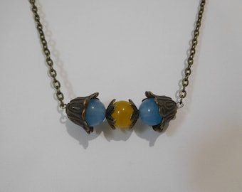 Blue and yellow agate with bronze flower beadcaps on 18 inch chain