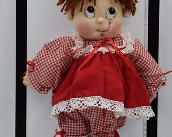 Little girl with red bows