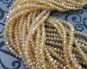 Chinese Crystal. 4 mm Rondelle Topaz AB Color.