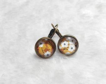Small mustard flower cabochon earrings