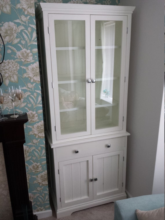 Split Level Bookcase With Glass Doors And Drawer