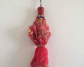Vintage 1960s Red Umbrella with Vibrant Floral Pattern
