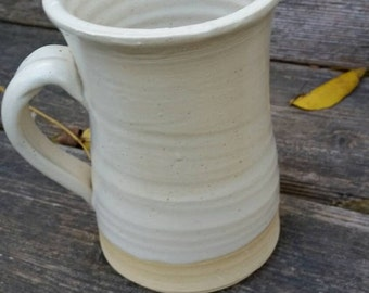 Pottery coffee mug holds 10 ounces in white modern clean elegant