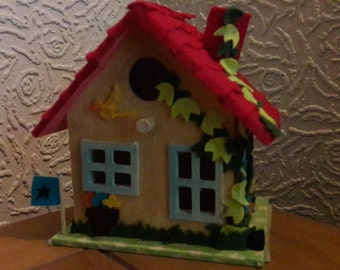 Red tiled birdhouse