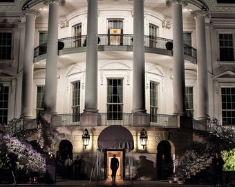 President Barack Obama enters the South Portico of the White House